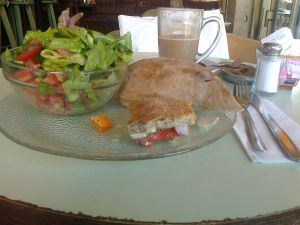 A Vegan Health Sandwich, with Vegetables and Tofu, a Small Salad and a Big Soy-Milk Latte`