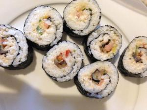Sushi with eggplants, tahin, Humus and salat. The Asian Union national dish