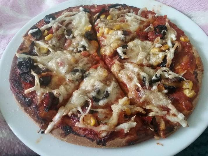 Spelt base pizza with roasted peppers & onions with olives ,sweetcorn & violife cheese yum...